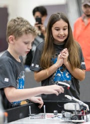 Halston Johnson and Victoria Busch compete with their team from IMAG in the Cypress Lake First LEGO League Qualifying Tournament at Cypress Lake Middle School in Fort Myers on Saturday, January 12, 2019.