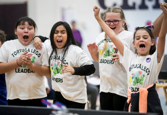 Tortuga Preserve Elementary School students Liliana Delgado, left, Briana Rodriguez, Camden Cumbess and Angelina Torres, right, cheer as their team, the Tortuga LEGO Leaders, compete in the Cypress Lake FIRST LEGO League Qualifying Tournament at Cypress Lake Middle School in Fort Myers on Saturday, January 12, 2019.