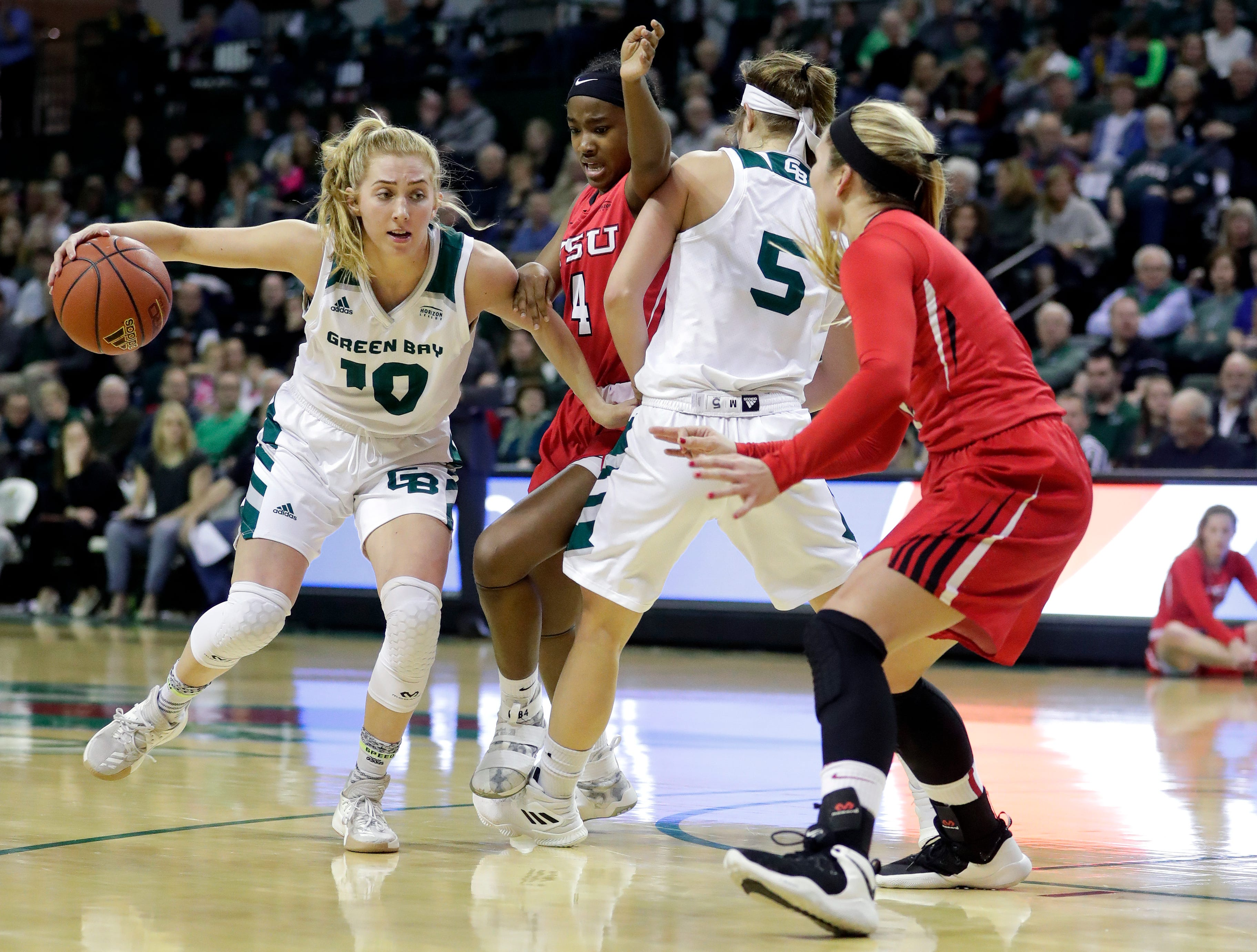 UWGB freshman guard Anna Brecht drives against the Youngstown State defense on Jan. 12, 2019 at the Kress Center. Sarah Kloepping/USA TODAY NETWORK-Wisconsin