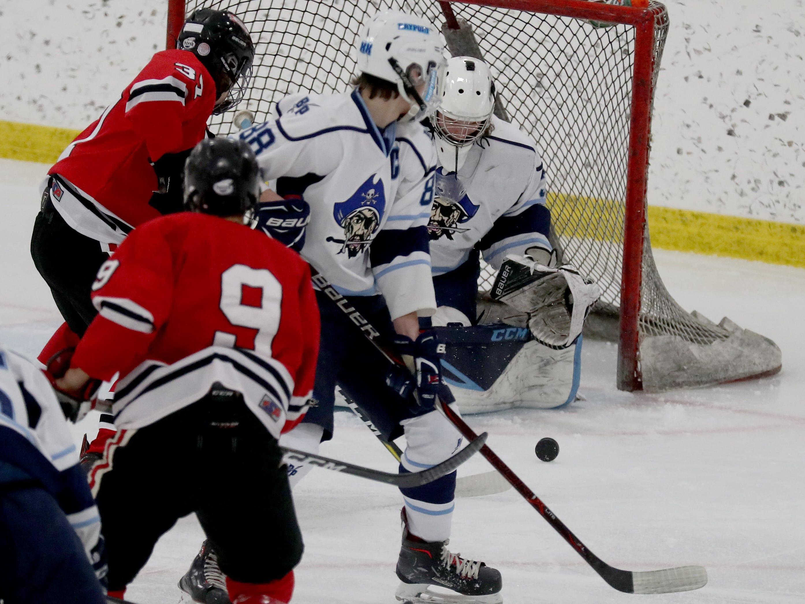 Bay Port goalie Kaden LeDocq stops a shot against Neenah-Hortonville-Menasha hockey Friday January 11, 2019 at Cornerstone Community Center in Ashwaubenon, Wis.