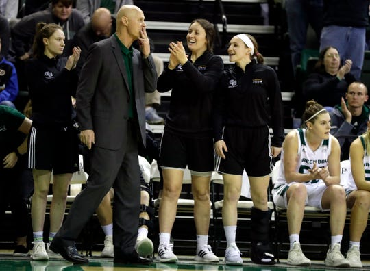 UWGB women's basketball coach Kevin Borseth is applauded after earning the 700th win of his career on Jan. 12, 2019 following the team's defeat of Youngstown State 60-42 at the Kress Center.