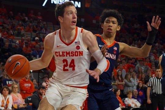 Clemson forward David Skara (24) drives to the basket while being defended by Virginia guard Kihei Clark (0) during the second half of the game at Littlejohn Coliseum.