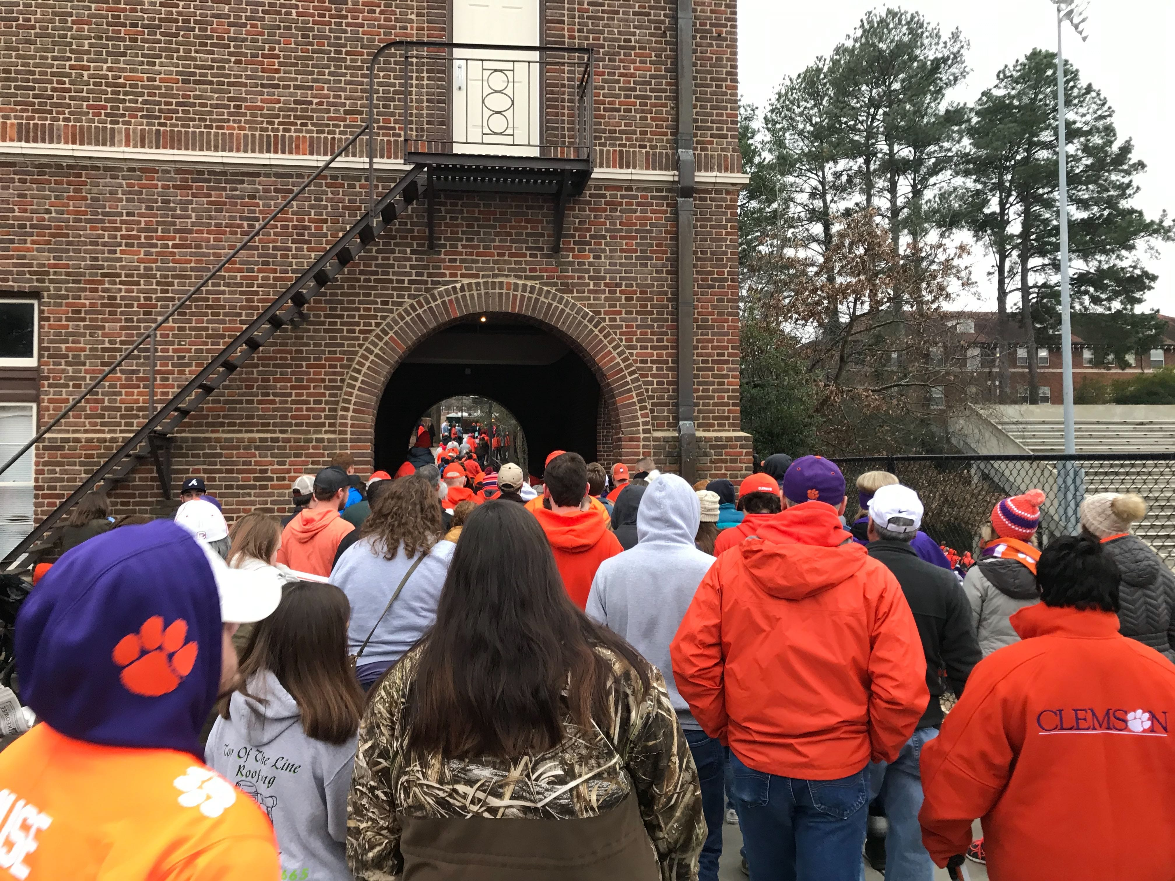 At the conclusion of the parade, Clemson fans flood toward Clemson Memorial Stadium for the second part of the celebration.