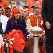 Clemson head coach Dabo Swinney laughs with his wife Kathleen during the Tigers National Championship celebration Saturday, January 12, 2019 at Clemson's Memorial Stadium.