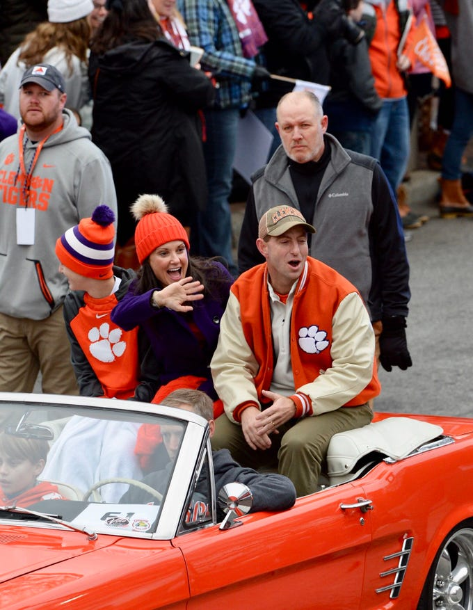 Clemson coach Dabo Swinney and his family stroll down Clemson Avenue during the championship celebration.