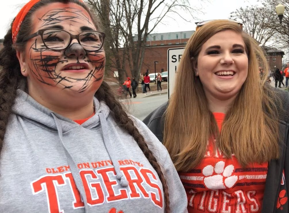 """Kasey Corley, left, Kayla Corley, right, and Carmen Shirey left Columbia at 5 a.m. this morning to make it to the parade. Kasey said her favorite moment was seeing players from past generations go by. """"It gave me chills,"""" she said."""