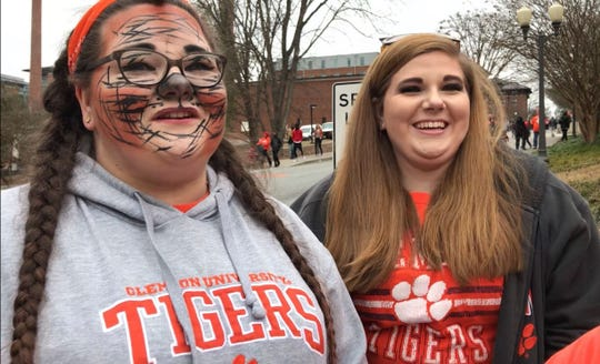 "Kasey Corley, left, Kayla Corley, right, and Carmen Shirey left Columbia at 5 a.m. this morning to make it to the parade. Kasey said her favorite moment was seeing players from past generations go by. ""It gave me chills,"" she said."