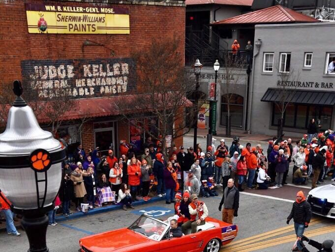 Clemson coach Dabo Swinney and his family roll down College Avenue during the Clemson Football parade.