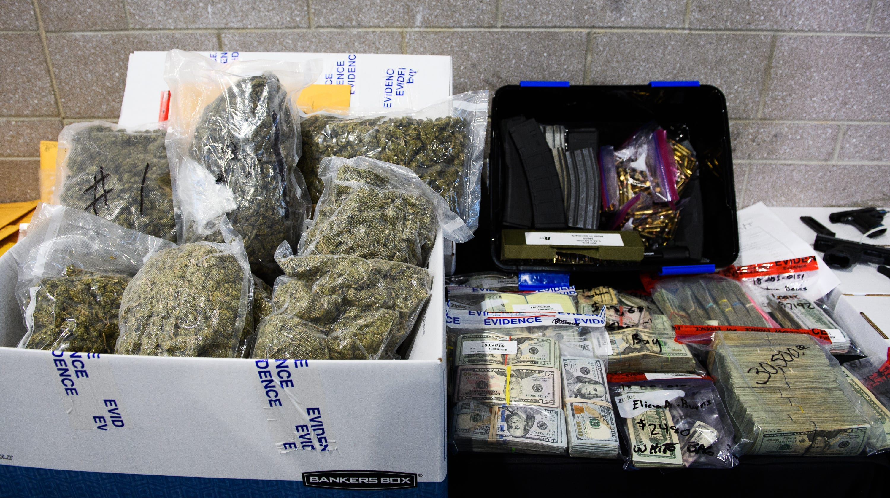 Large quantities of marijuana, money, firearms and other contraband sit on display during a Spartanburg County Sheriff's Office press conference on Operation Rolling Thunder's seizures on May 4, 2018.
