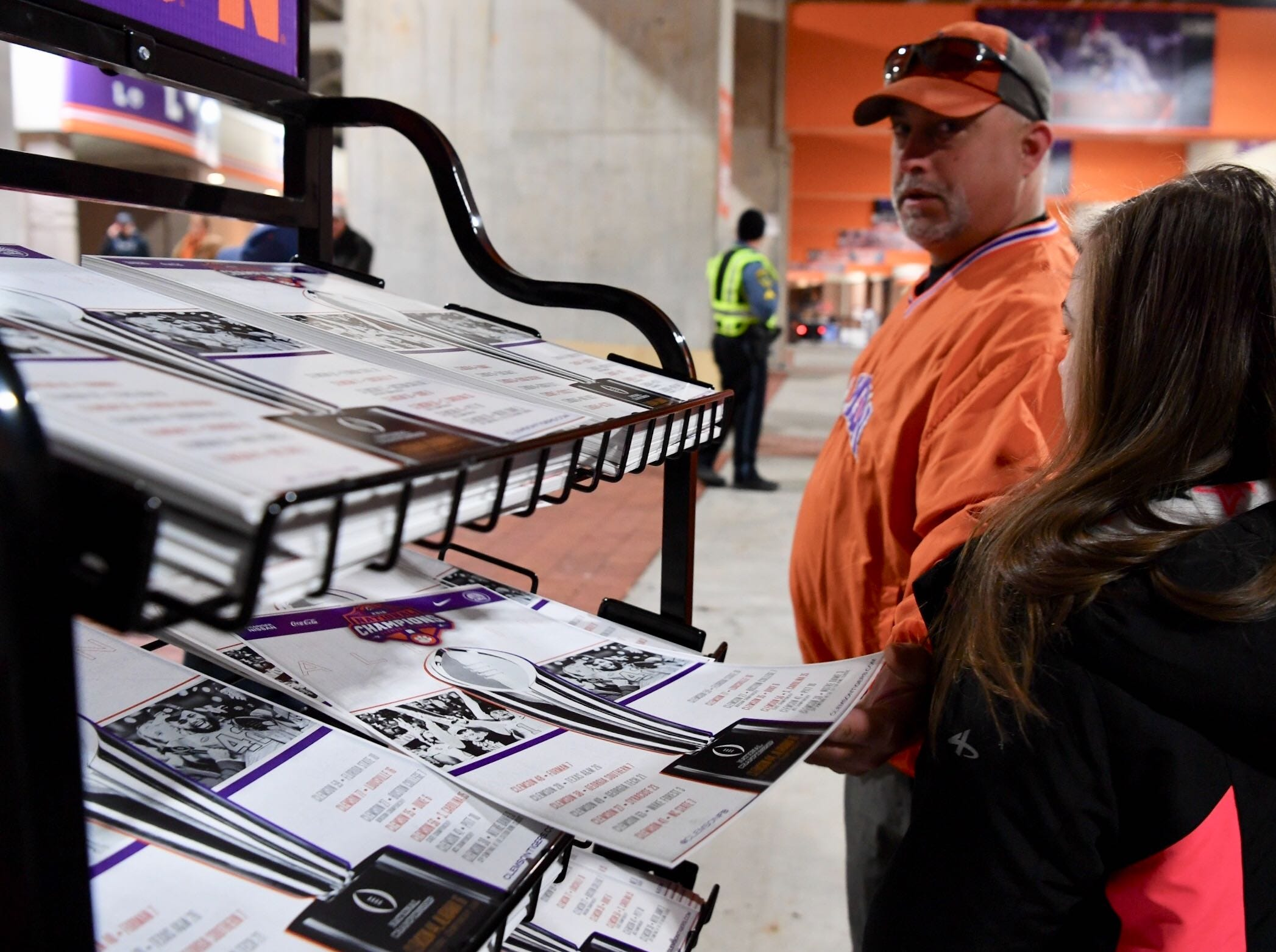 Chris Carpenter and daughter Trinity Carpenter of Asheville get a commemorative poster inside Memorial Stadium on Saturday.
