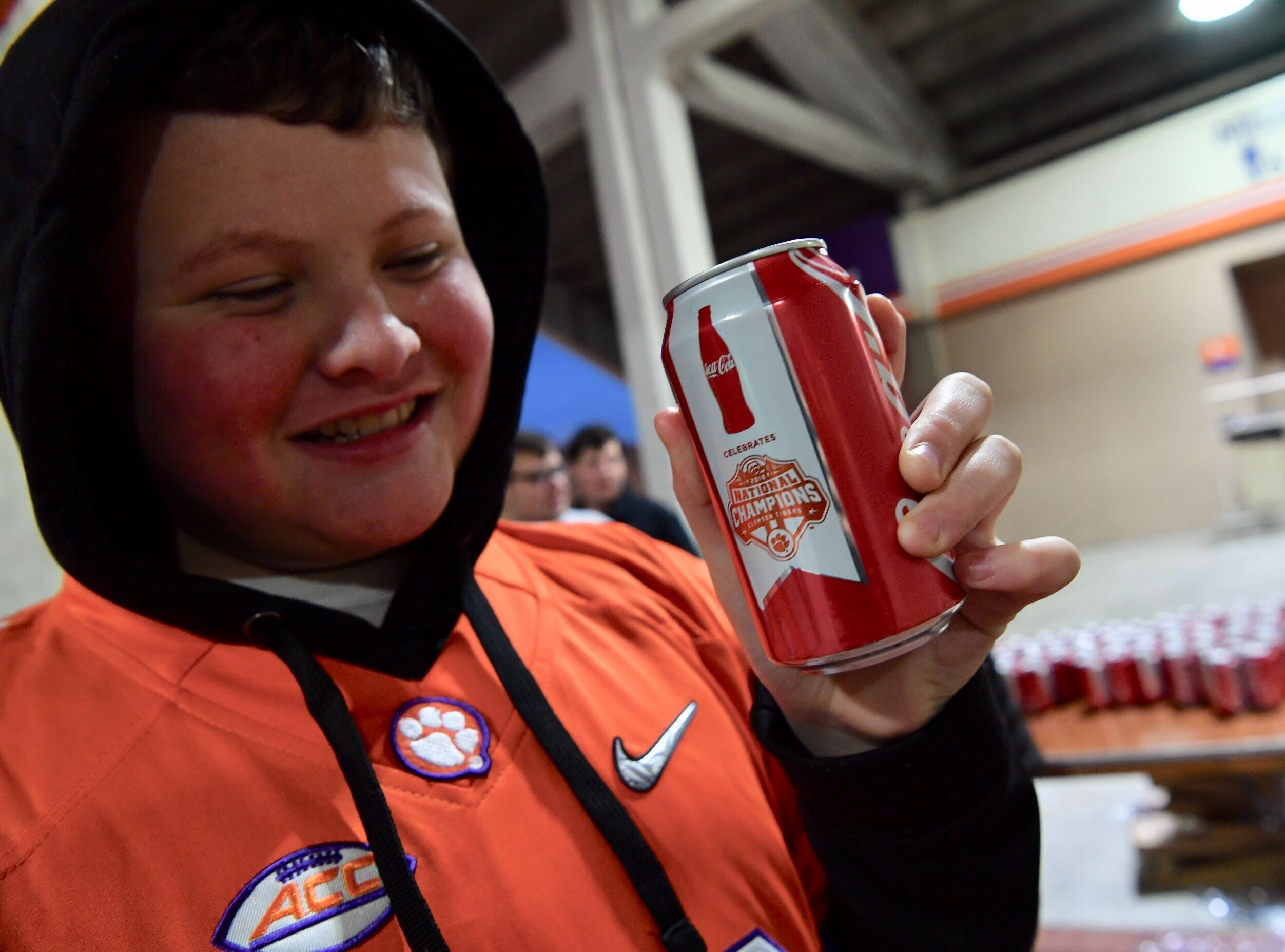 James Dean of Clinton holds one of the Clemson National Championship Coke cans given to first 2,400 at Memorial Stadium on Saturday.
