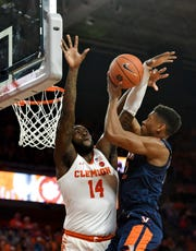 Virginia's DeAndre Hunter drives to the basket while defended by Clemson's Elijah Thomas during the first half Saturday in Clemson.