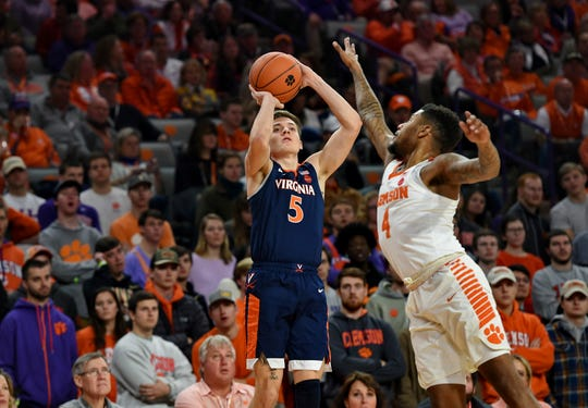 Virginia's Kyle Guy shoots a 3-pointer over Clemson's Shelton Mitchell during the first half Saturday in Clemson.