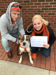Nora and Andy Barnes with their dog, Dabo. They're from Asheville but they come down regularly. Their honeymoon was the Georgia Southern game in September. Dabo is in training to become a therapy dog.