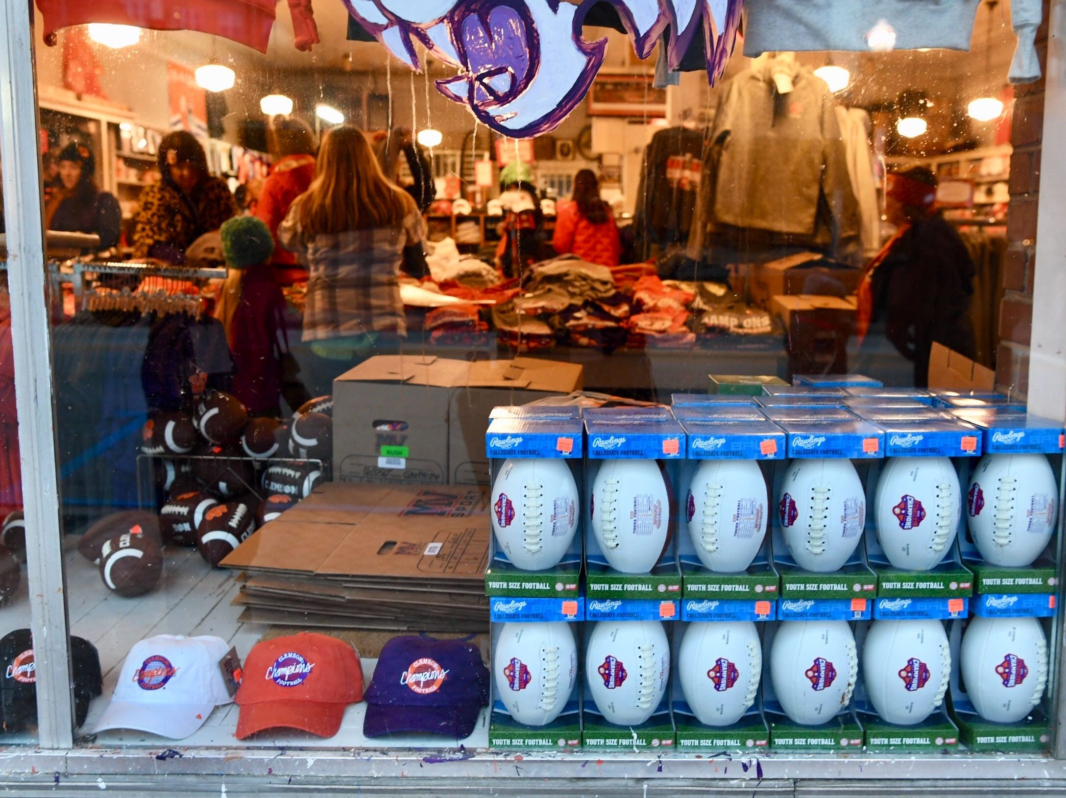People shopping for championship items at Judge Keller General Merchandise store on College Avenue in Clemson on Saturday.
