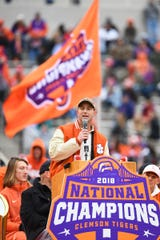 Clemson coach Dabo Swinney addresses fans and media at the national championship celebration at Clemson Memorial Field.