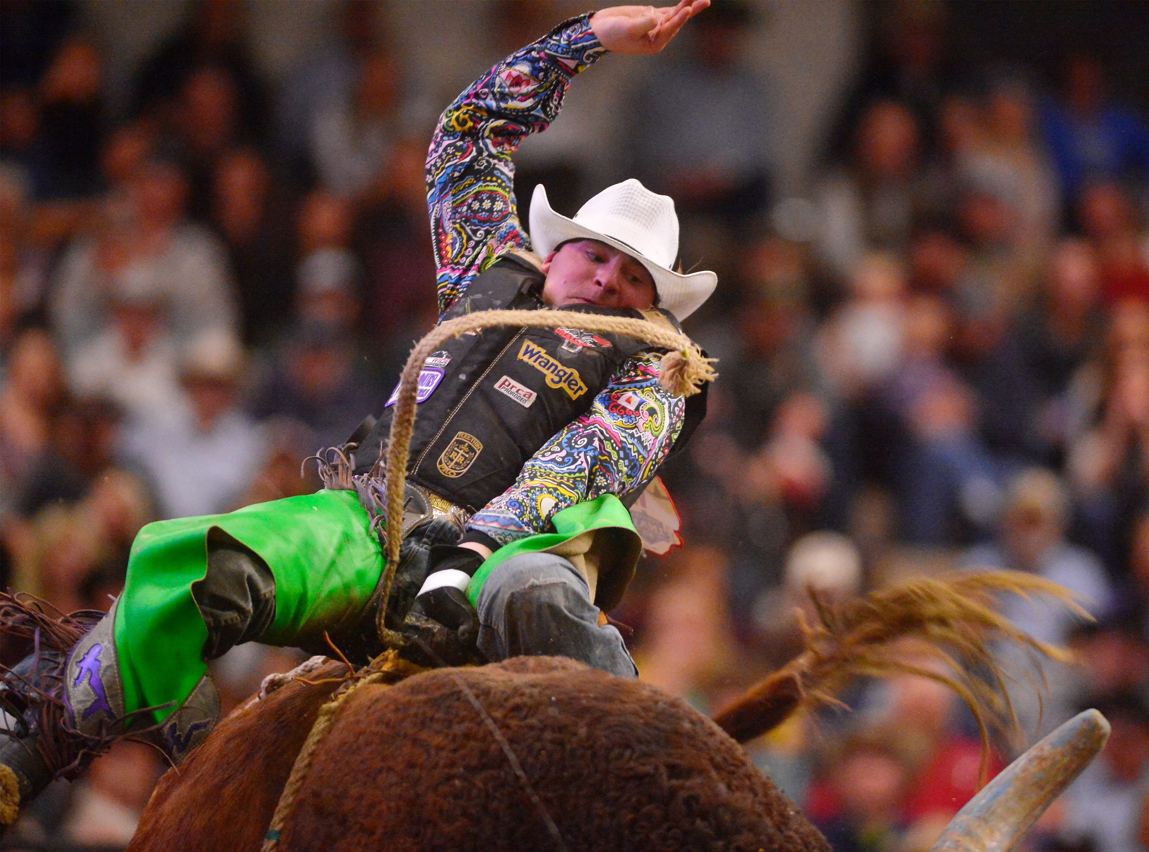 Hawk Whitt rides in the bull riding event during the Montana Pro Rodeo Circuit Finals in the Pacific Steel and Recycling Four Seasons Arena, Friday, January 11, 2019.