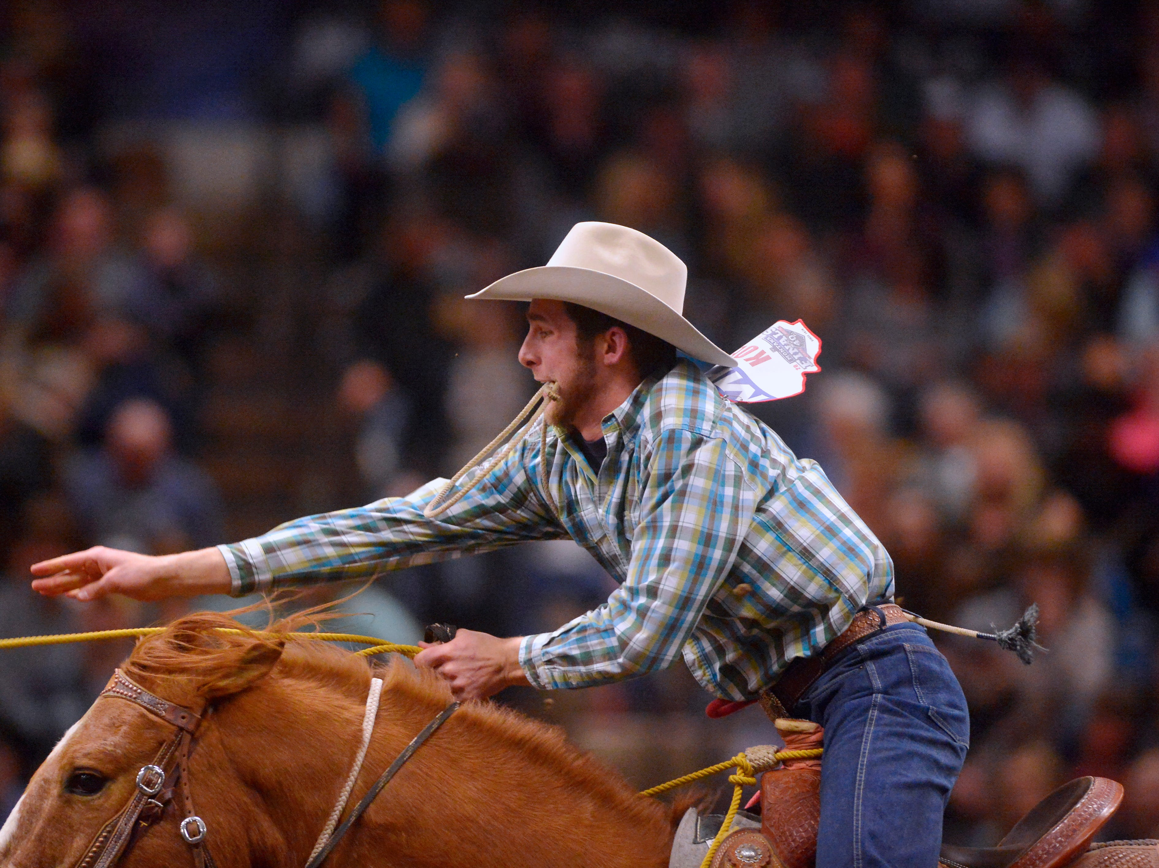 Al Koenig throws his loop in the tie-down roping event during the Montana Pro Rodeo Circuit Finals in the Pacific Steel and Recycling Four Seasons Arena, Friday, January 11, 2019.