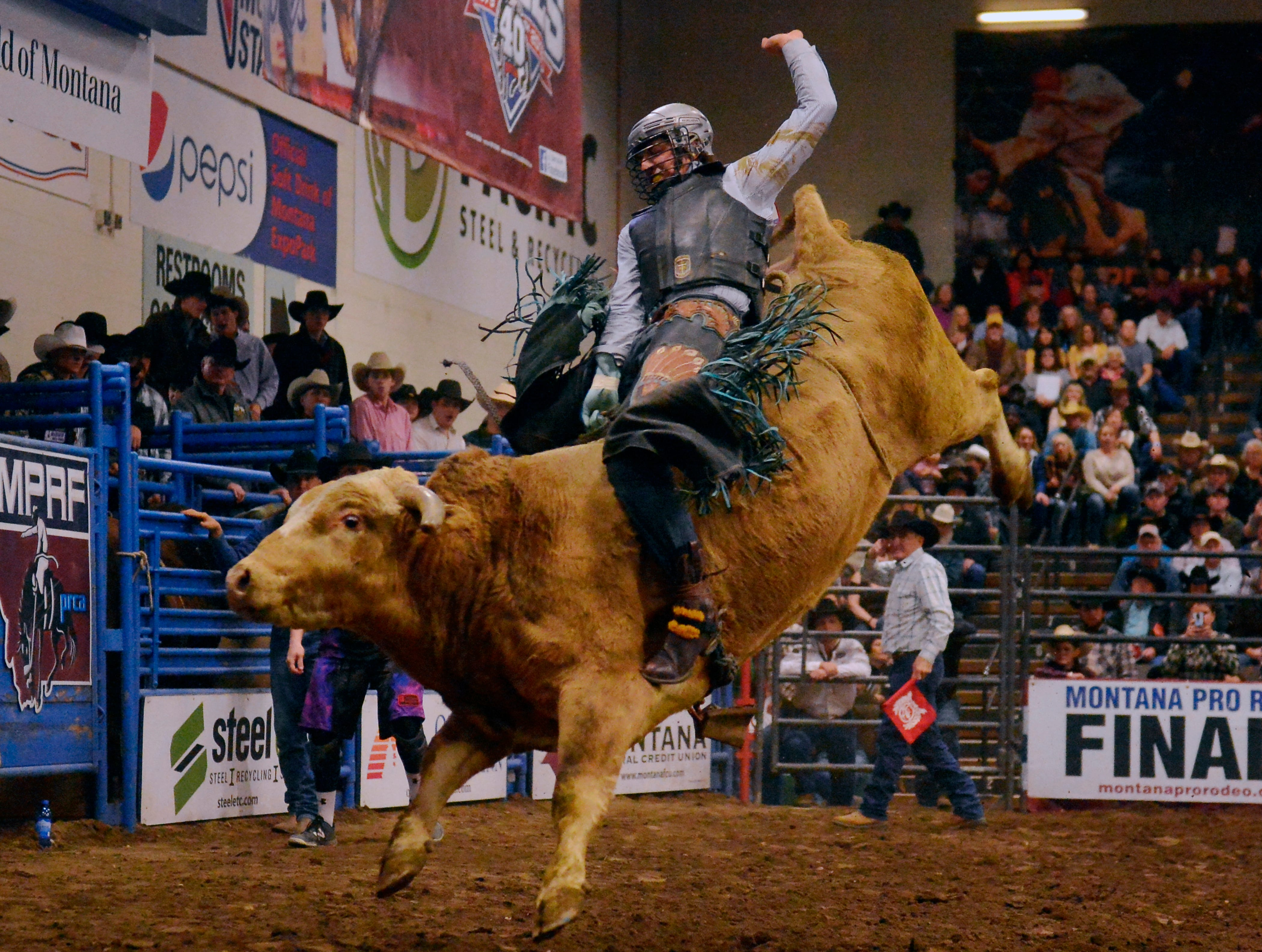 Casey Fredricks rides in the bull riding event during the Montana Pro Rodeo Circuit Finals in the Pacific Steel and Recycling Four Seasons Arena, Friday, January 11, 2019.