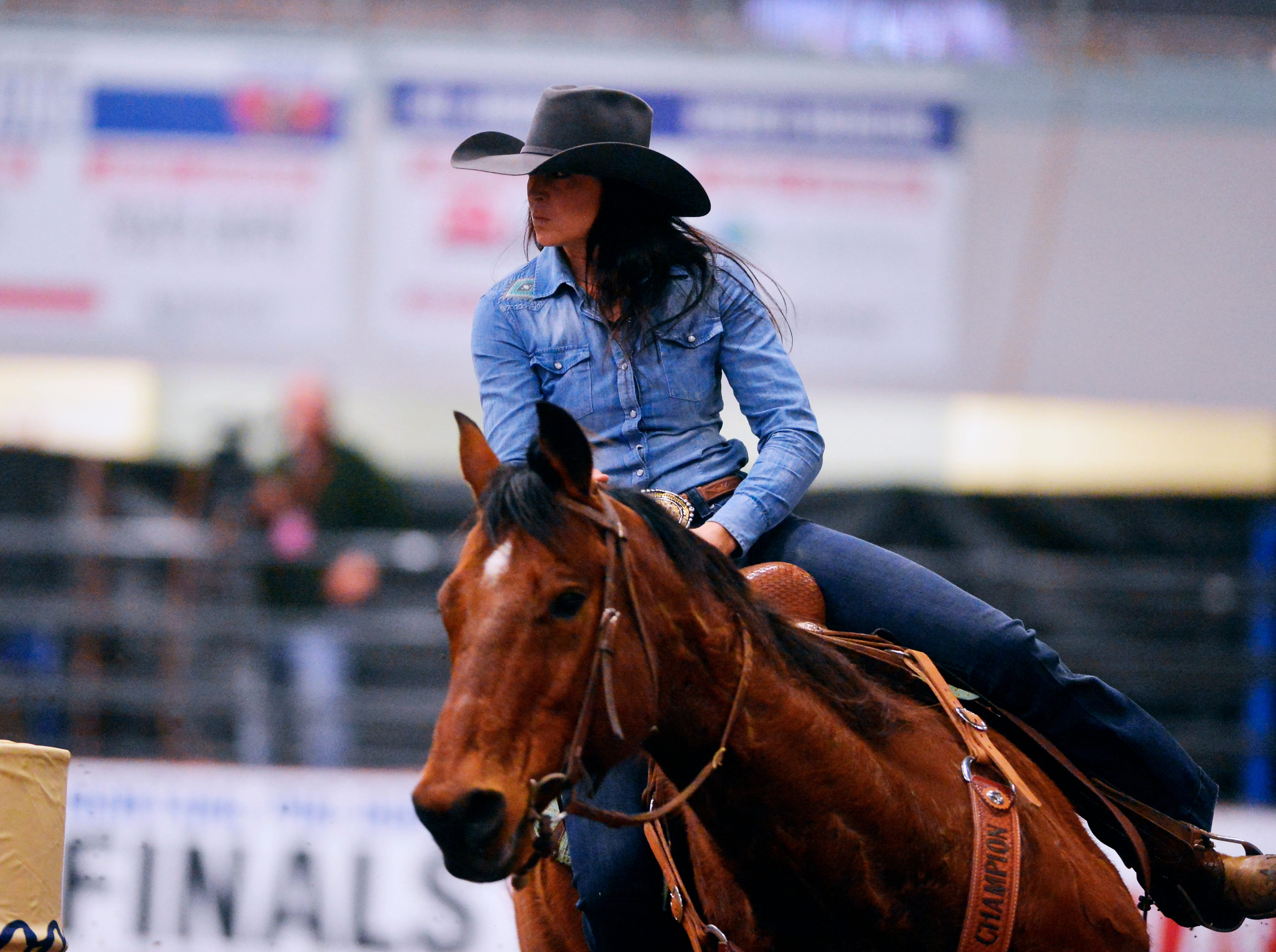 Hannah Sharon makes a 13.20 second run in the barrel racing event during the Montana Pro Rodeo Circuit Finals in the Pacific Steel and Recycling Four Seasons Arena, Friday, January 11, 2019.