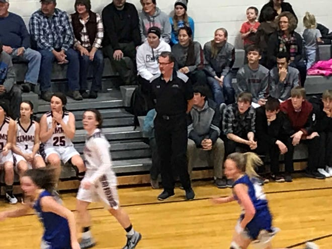 Simms girls' basketball coach Truitt Kinna keeps a careful eye on his squad on offense in their District 10C game against Great Falls Central Friday night at the Simms Gym.