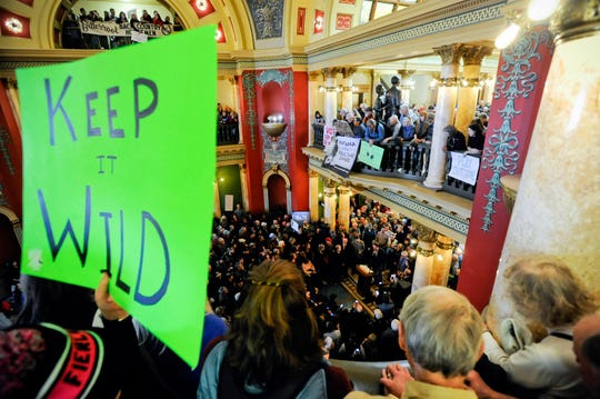 About 2,000 people filled the Montana Capitol for a rally to urge state and federal lawmakers to protect public lands, Friday, Jan. 11, 2019, in Helena, Mont. (Thom Bridge/Independent Record via AP)