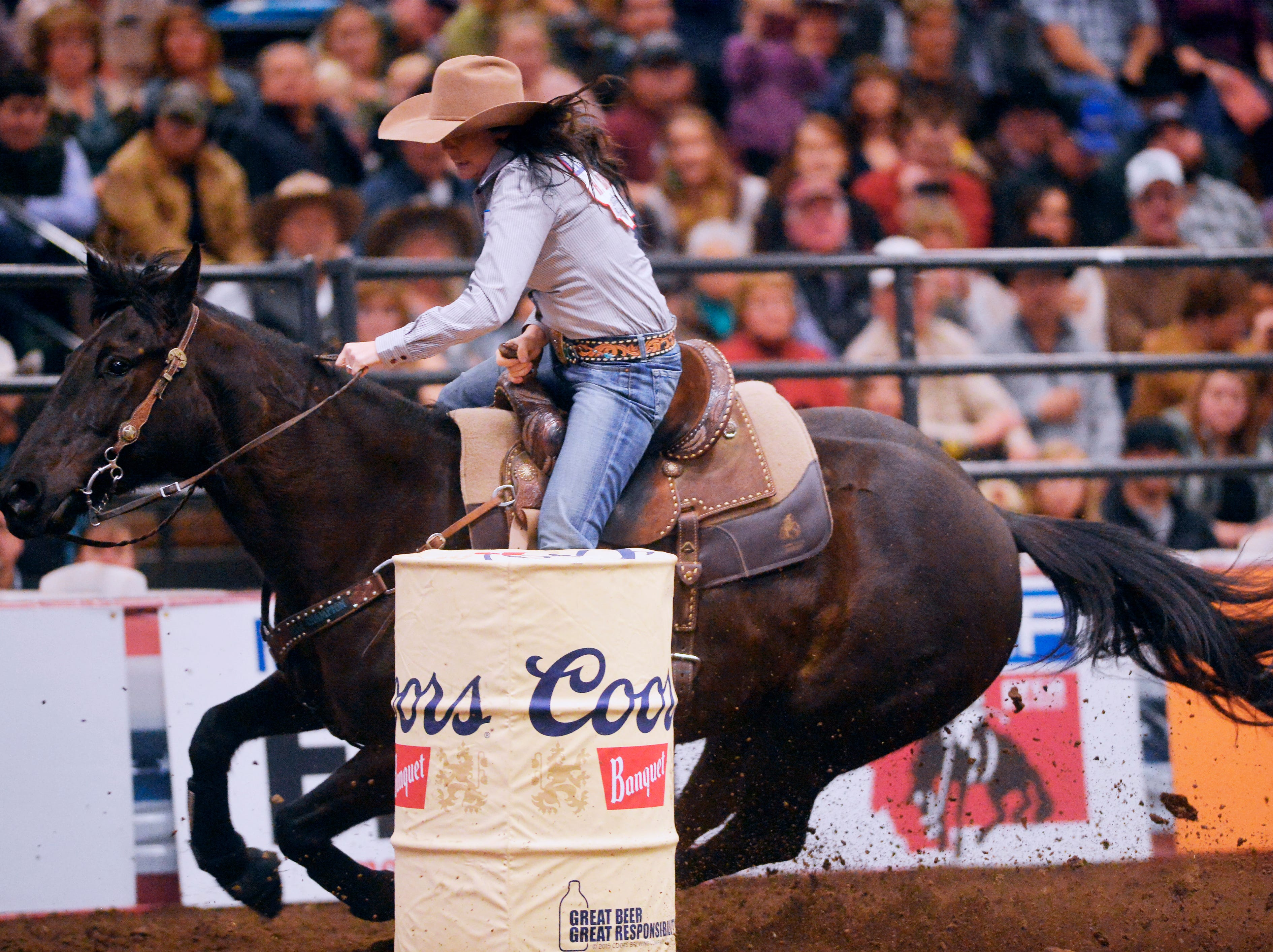 Heather Crowley attemtps her second barrel in the barrel racing event during the Montana Pro Rodeo Circuit Finals in the Pacific Steel and Recycling Four Seasons Arena, Friday, January 11, 2019.