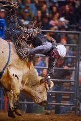 Nevada Newman attempts to ride Blind Spot in the bull riding event during the Montana Pro Rodeo Circuit Finals in the Pacific Steel and Recycling Four Seasons Arena, Friday, January 11, 2019.
