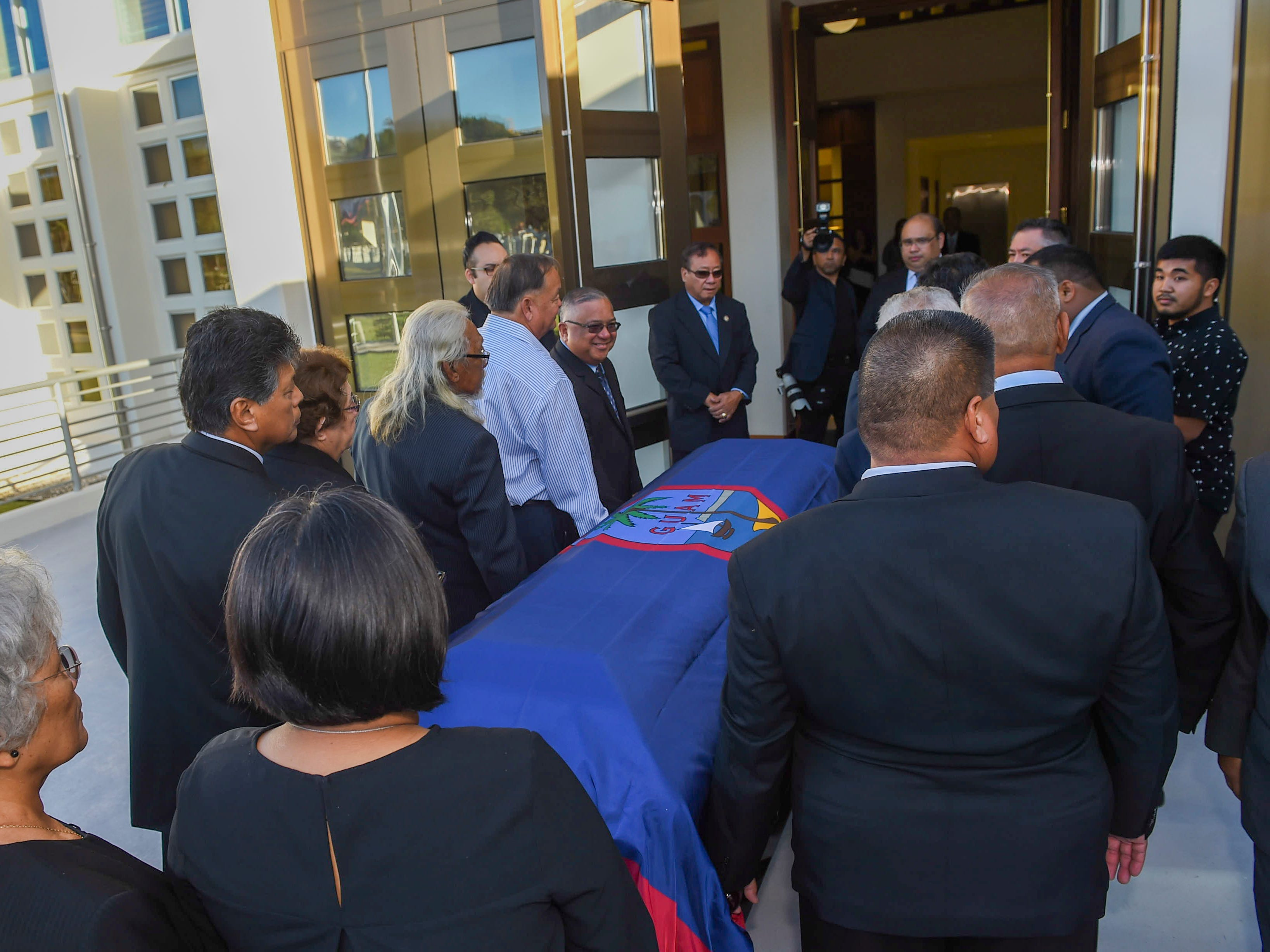 "Village mayors and family members carry the casket of former Piti Mayor Vicente ""Ben"" Gumataotao, during his state funeral at the Guam Congress Building on Jan. 12, 2019."