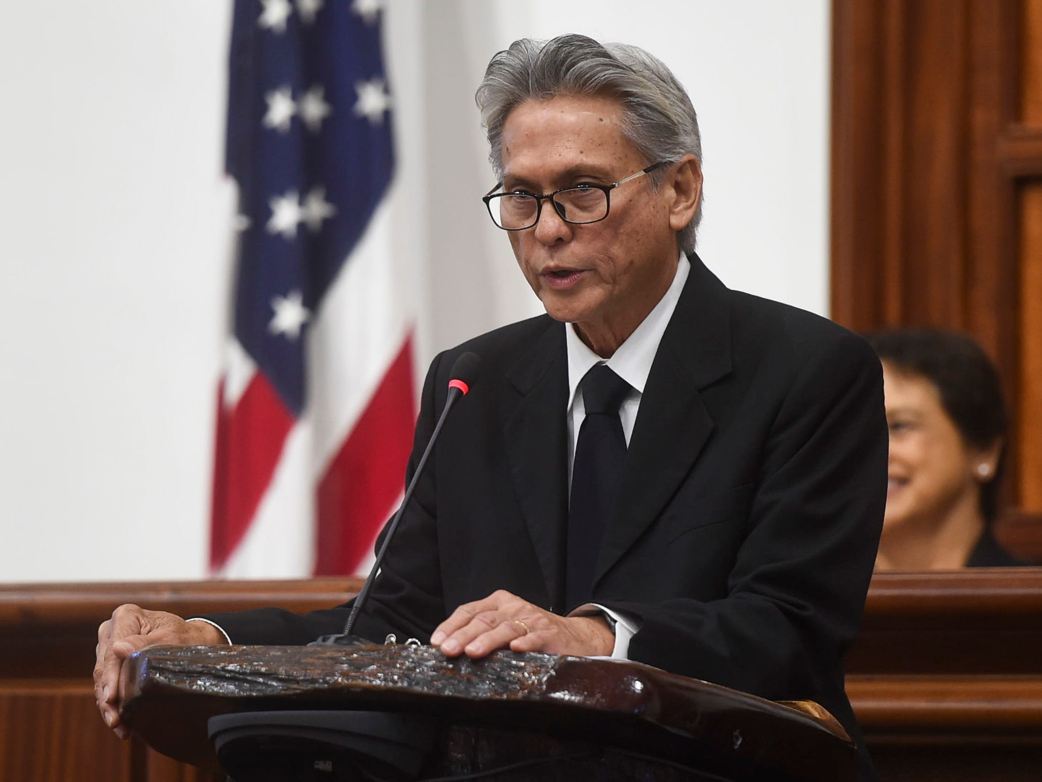 "Phillip Carbullido, associate justice of the Supreme Court of Guam, delivers the eulogy during the state memorial service of former Piti Mayor Vicente ""Ben"" Gumataotao, at the Guam Congress Building on Jan. 12, 2019."