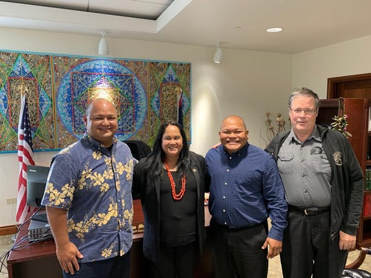 Speaker Tina Muna Barnes gets a visit from Education Superintendent Jon Fernandez, left, and Guam Education Board chairman Mark Mendiola and Ron McNinch, right, on Jan. 11, 2019.