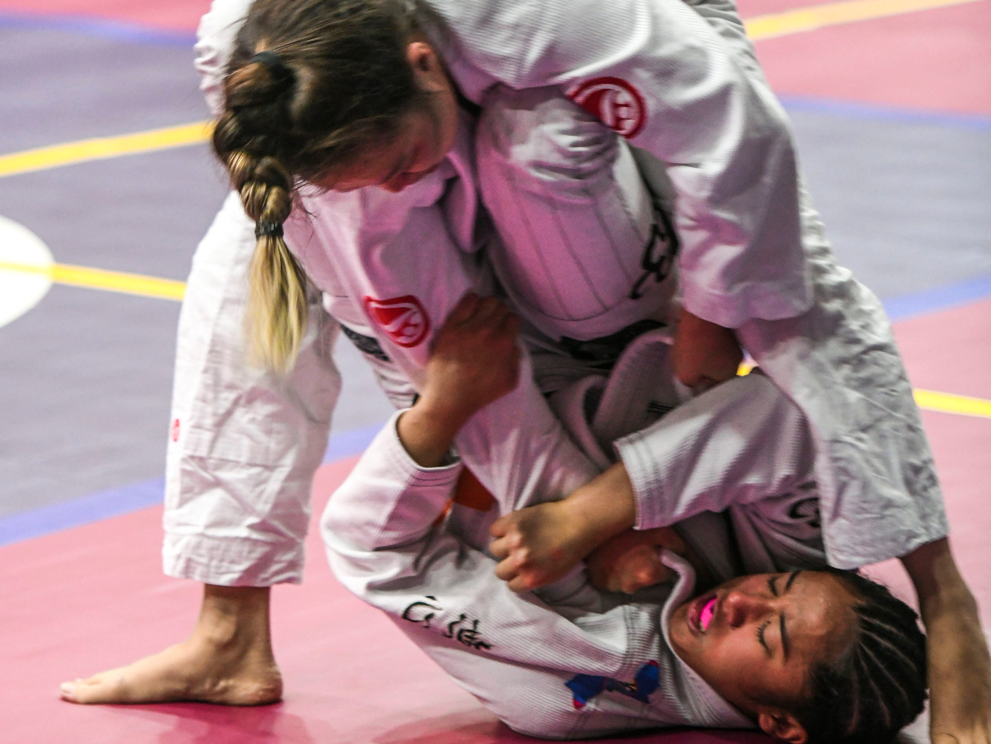 Martial artists, in varying ages and weight divisions, compete against each other during the Copa De Marianas Brazilian Jiujitsu Tournament at the Father Duenas Memorial School's Phoenix Center in Mangilao on Saturday, Jan. 12, 2019.