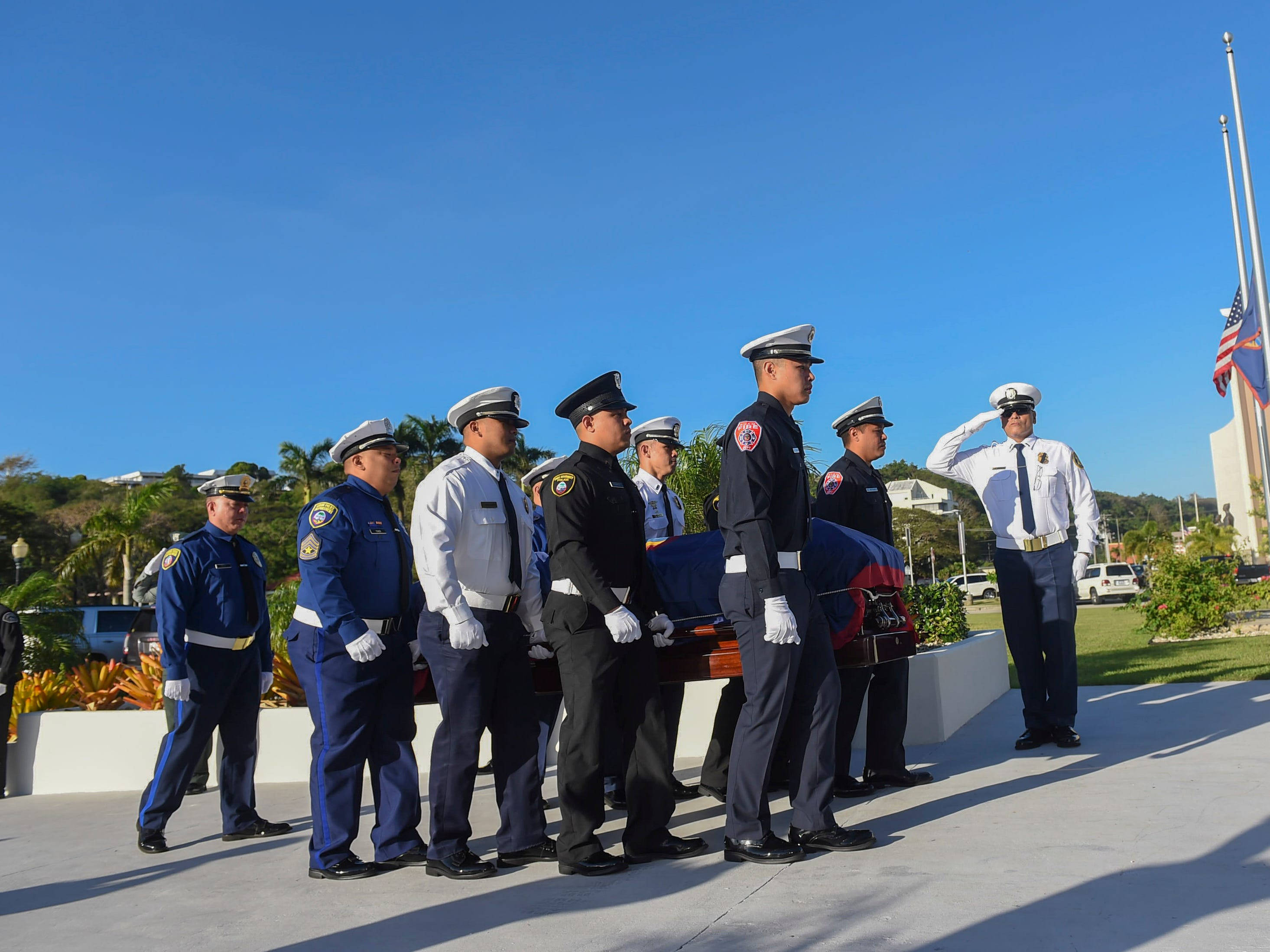 "Firefighters and and law enforcement officers transport the casket of former Piti Mayor Vicente ""Ben"" Gumataotao, during his state memorial service at the Guam Congress Building on Jan. 12, 2019."