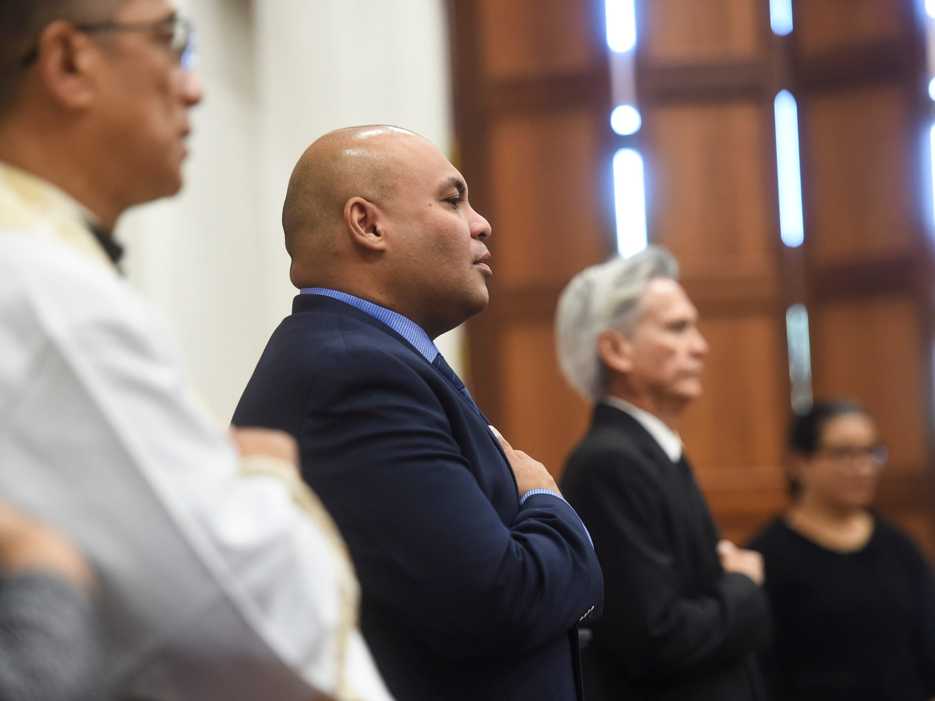 "Lt. Gov. Josh Tenorio, center, attends the state memorial service of former Piti Mayor Vicente ""Ben"" Gumataotao, at the Guam Congress Building on Jan. 12, 2019."