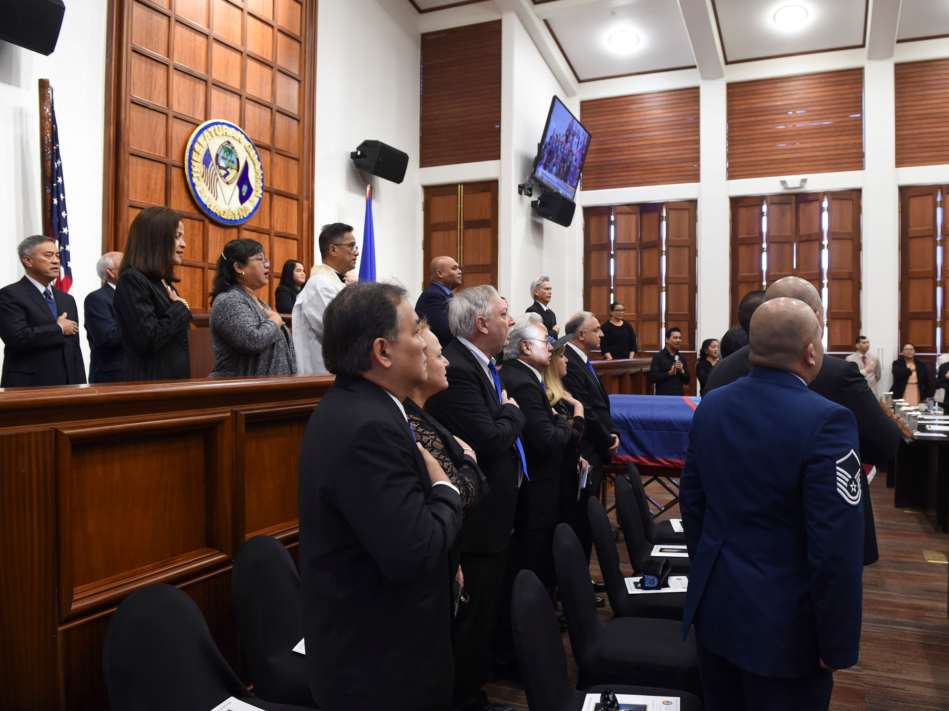"Dignitaries and family members mourn the passing of former Piti Mayor Vicente ""Ben"" Gumataotao, during his state memorial service at the Guam Congress Building on Jan. 12, 2019."