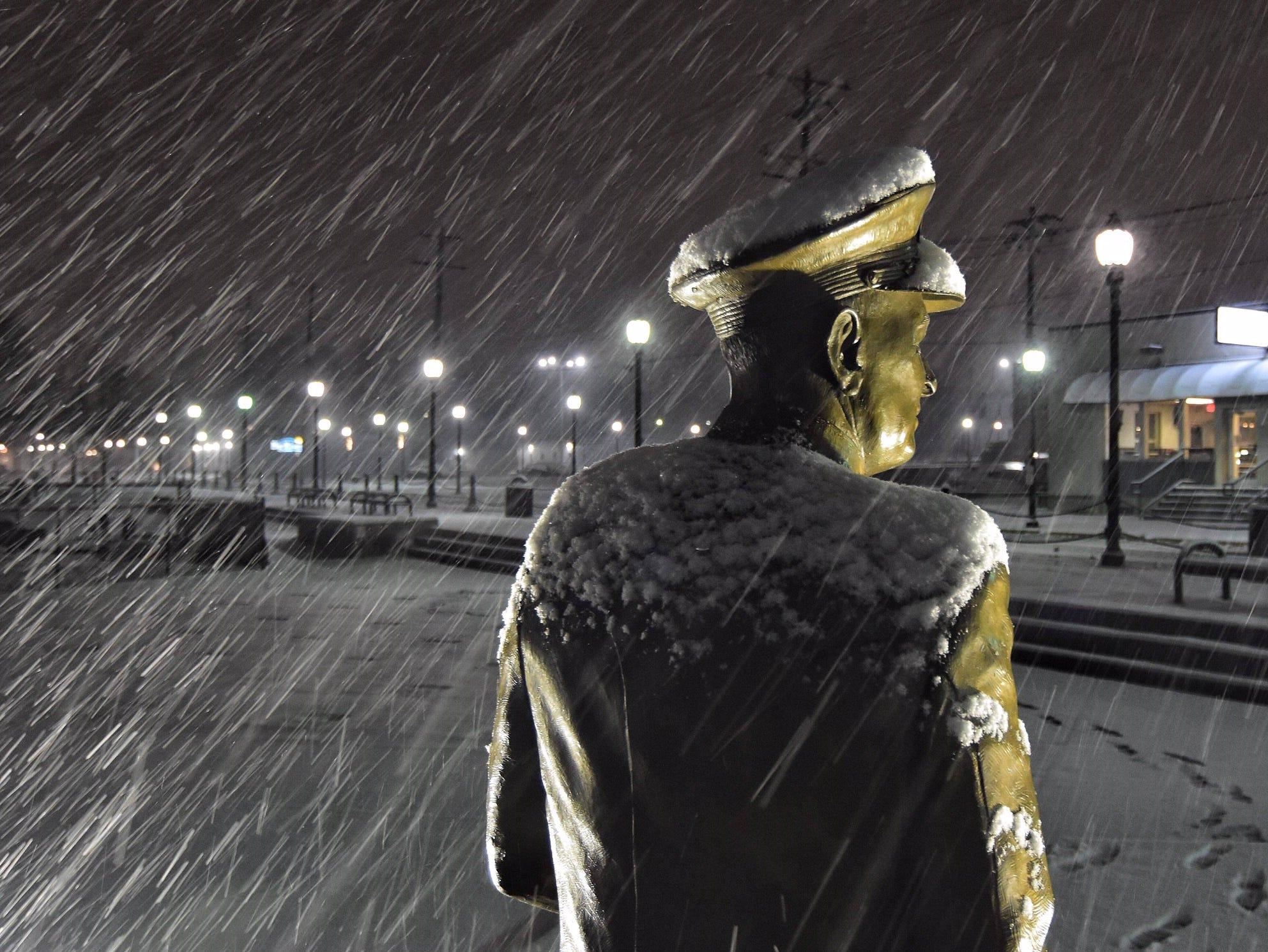 Admiral Husband E. Kimmel keeps a steadfast watch in the snow and sleet.