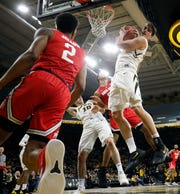 Luka Garza jumps for one of his four rebounds in Iowa's 72-62 win against Ohio State. The sophomore center led the Hawkeyes with 16 points compared to Ohio State big man Kaleb Wesson's two.