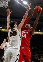 Ohio State center Kaleb Wesson tries to score as Iowa center Luka Garza defends during the first half of the Hawkeyes' victory Saturday at Carver-Hawkeye Arena.