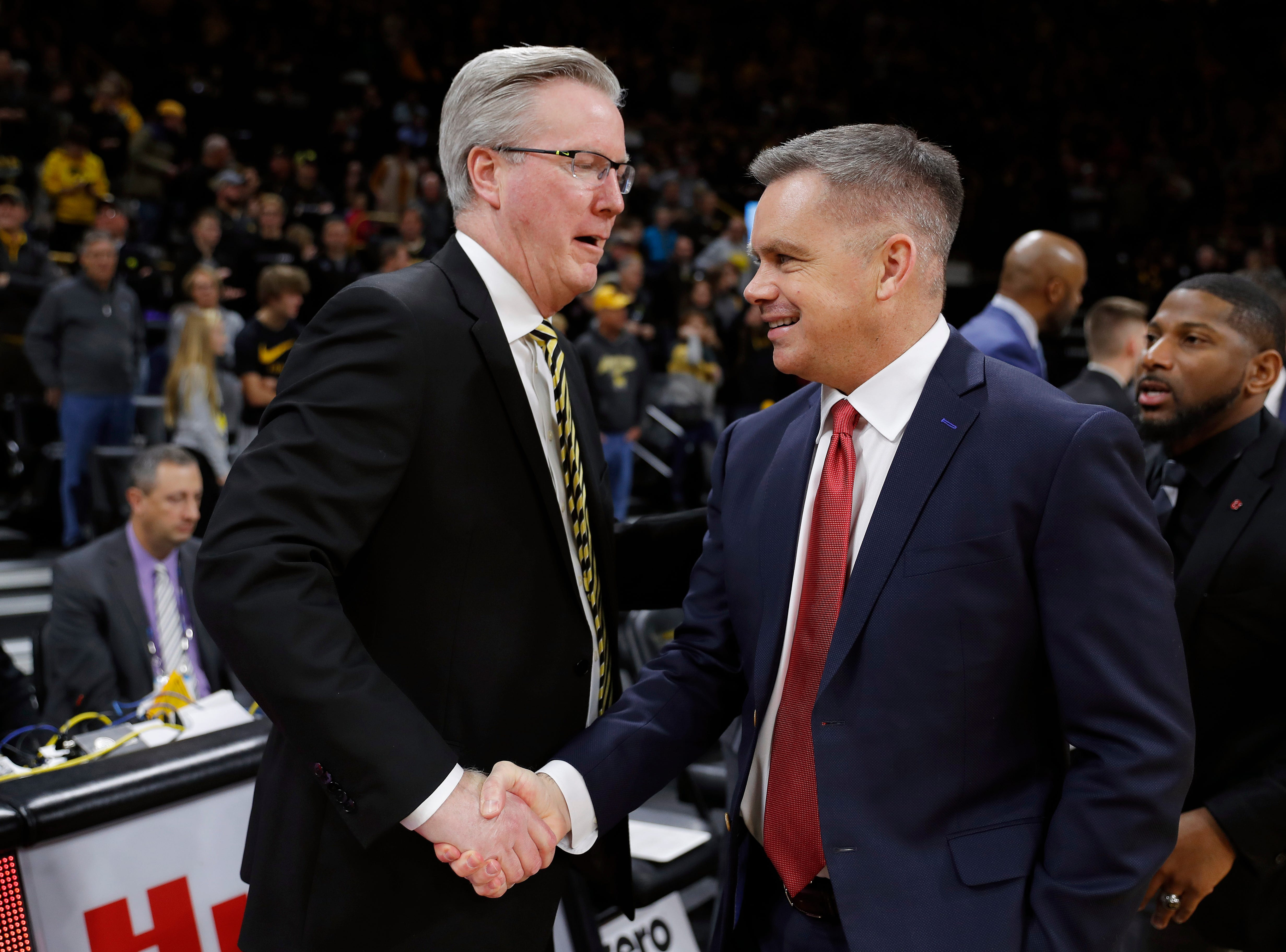Iowa head coach Fran McCaffery, left, greets Ohio State head coach Chris Holtmann before an NCAA college basketball game, Saturday, Jan. 12, 2019, in Iowa City, Iowa.