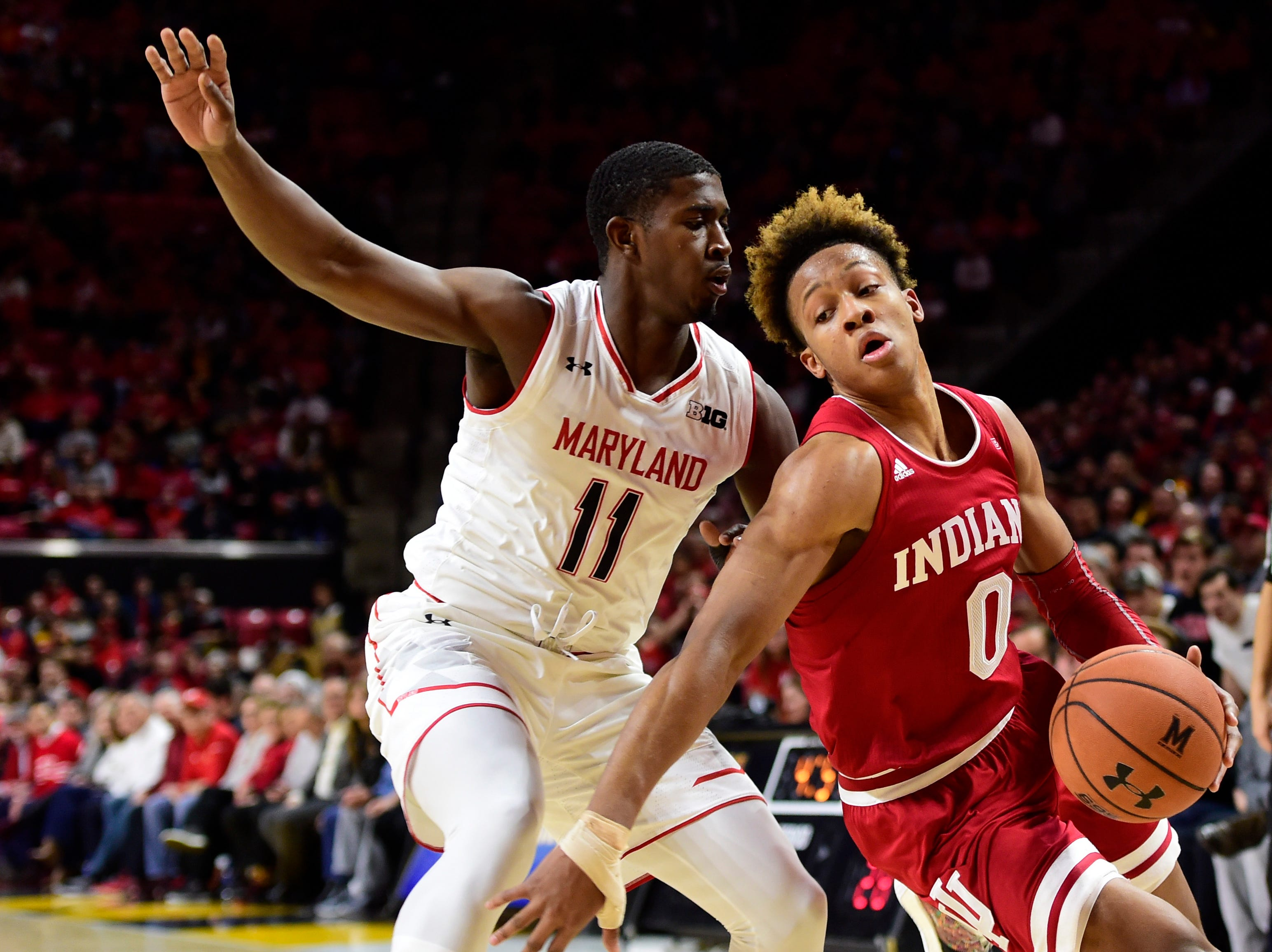 Jan 11, 2019; College Park, MD, USA;  Indiana Hoosiers guard Romeo Langford (0) dribbles as Maryland Terrapins guard Darryl Morsell (11) defends during the first half at XFINITY Center. Mandatory Credit: Tommy Gilligan-USA TODAY Sports