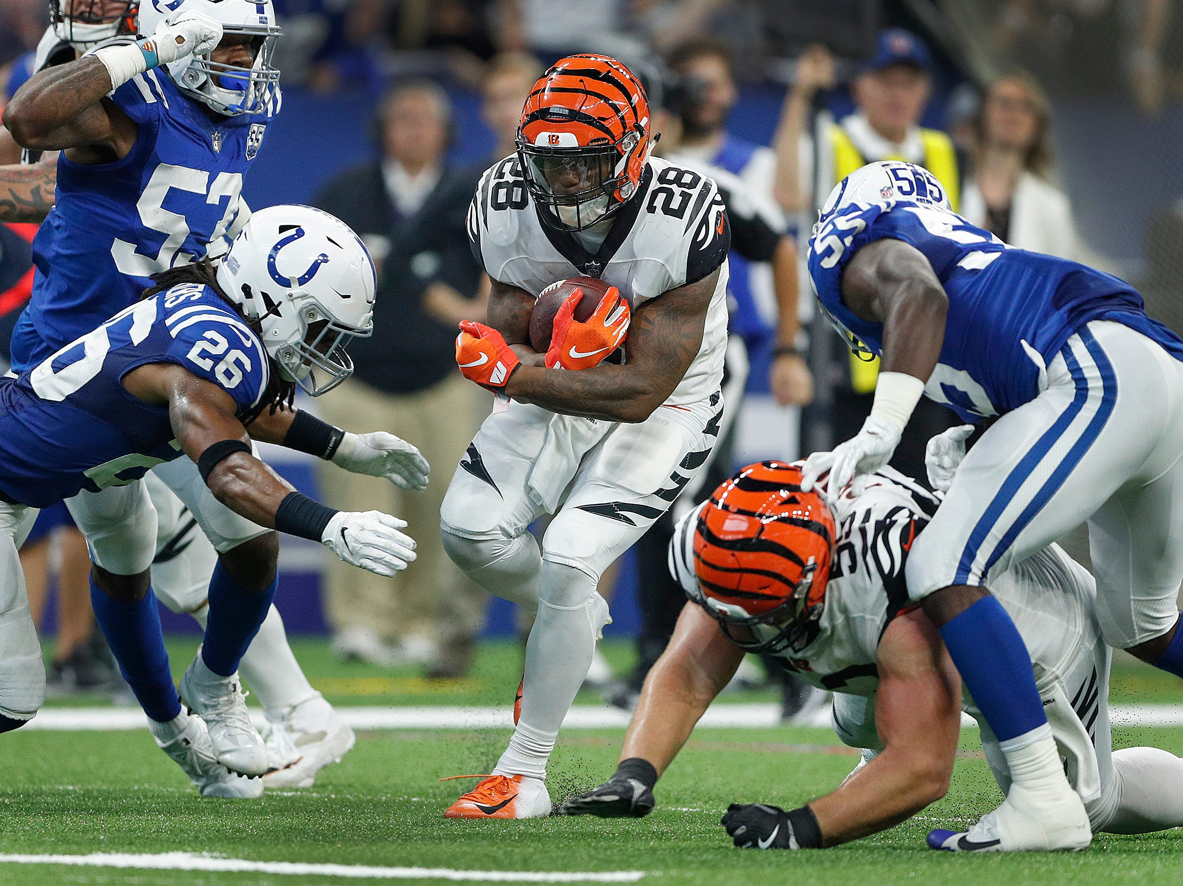 Cincinnati Bengals running back Joe Mixon (28) runs into the Colts secondary and Indianapolis Colts defensive back Clayton Geathers (26) in the second half of their game at Lucas Oil Stadium on Sept. 9, 2018. The Indianapolis Colts lost to the Cincinnati Bengals 34-23.