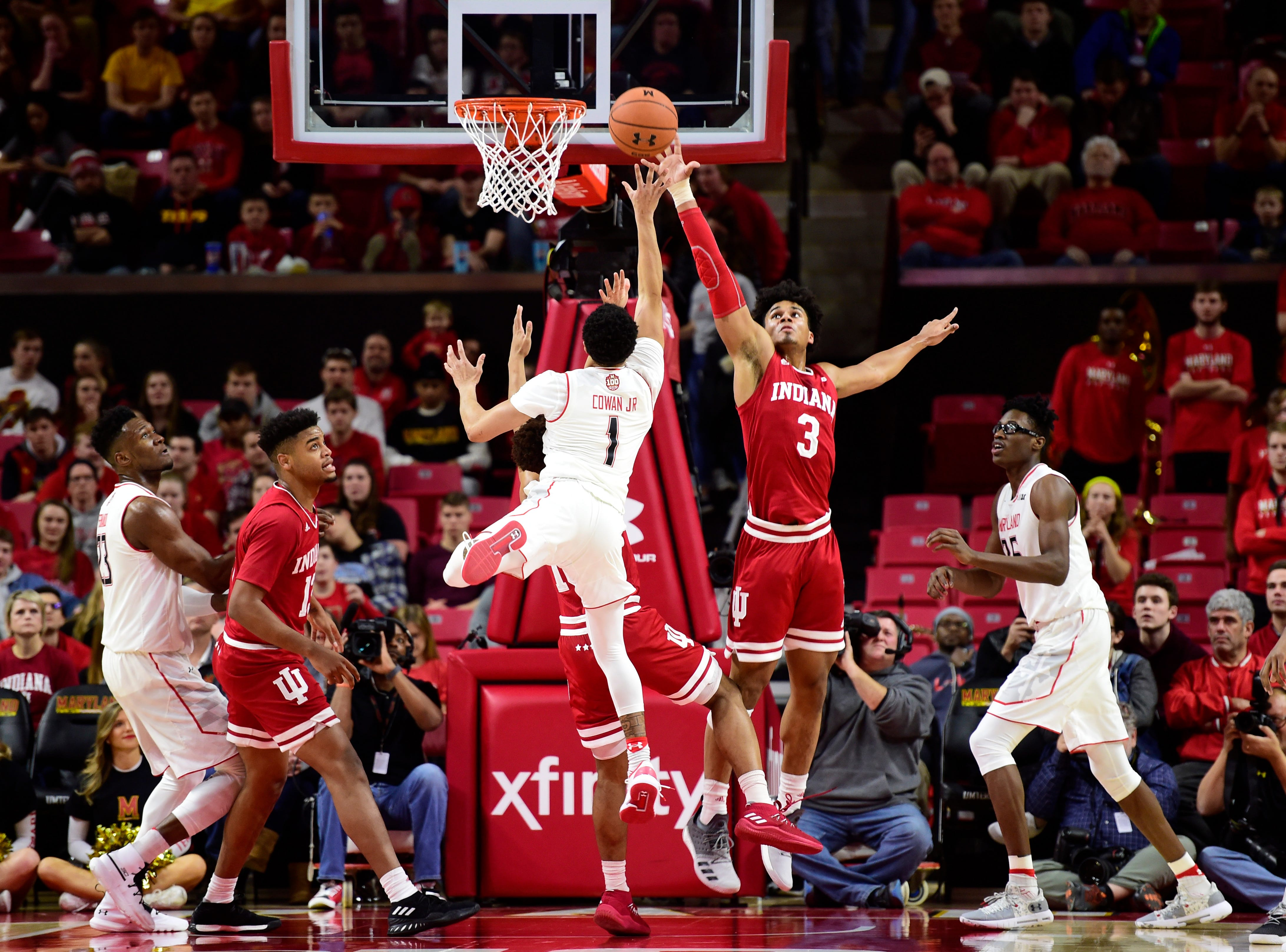 Jan 11, 2019; College Park, MD, USA;  Indiana Hoosiers forward Justin Smith (3) defends Maryland Terrapins guard Anthony Cowan Jr. (1) shot in the first half at XFINITY Center. Mandatory Credit: Tommy Gilligan-USA TODAY Sports