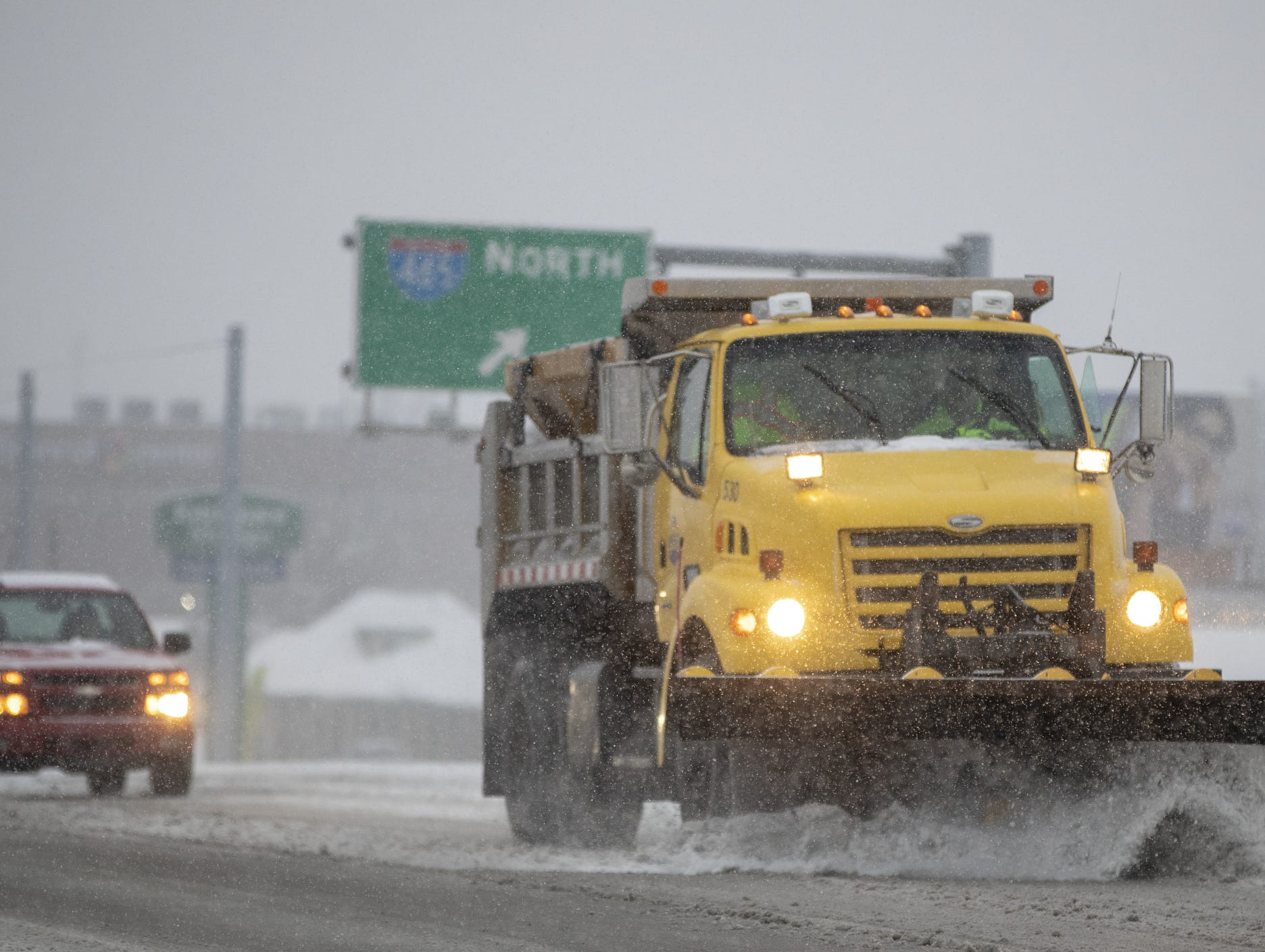 A snow plow works on 56th street, where it crosses 465 on the city's east side, on a day where 5-7 inches of snow is expected to fall in Central Indiana, Indianapolis, Saturday, Jan. 12, 2019.