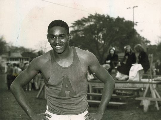 Johnny Wilson poses at a track meet for Anderson High.