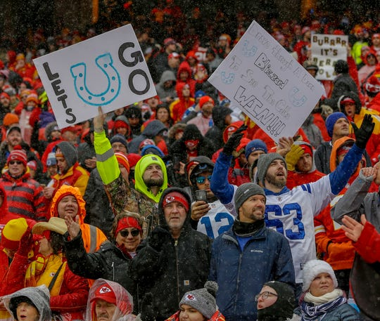 Indianapolis Colts fans cheer inside the Kansas City Chiefs' Arrowhead Stadium in Kansas City, Mo., on Saturday, Jan. 12, 2019.