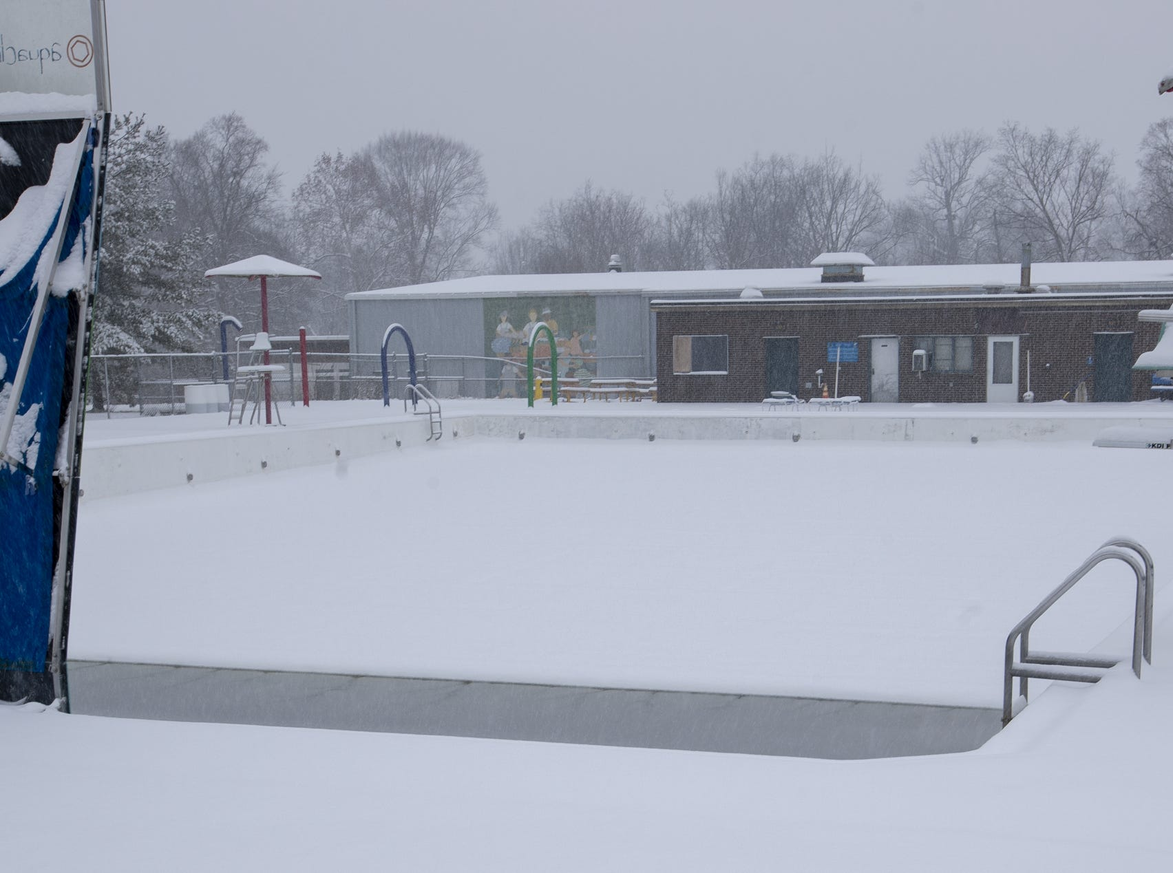The snow-covered pool at Ellenberger Park, drained for the season, on a day where 5-7 inches of snow is expected to fall in Central Indiana, Indianapolis, Saturday, Jan. 12, 2019.