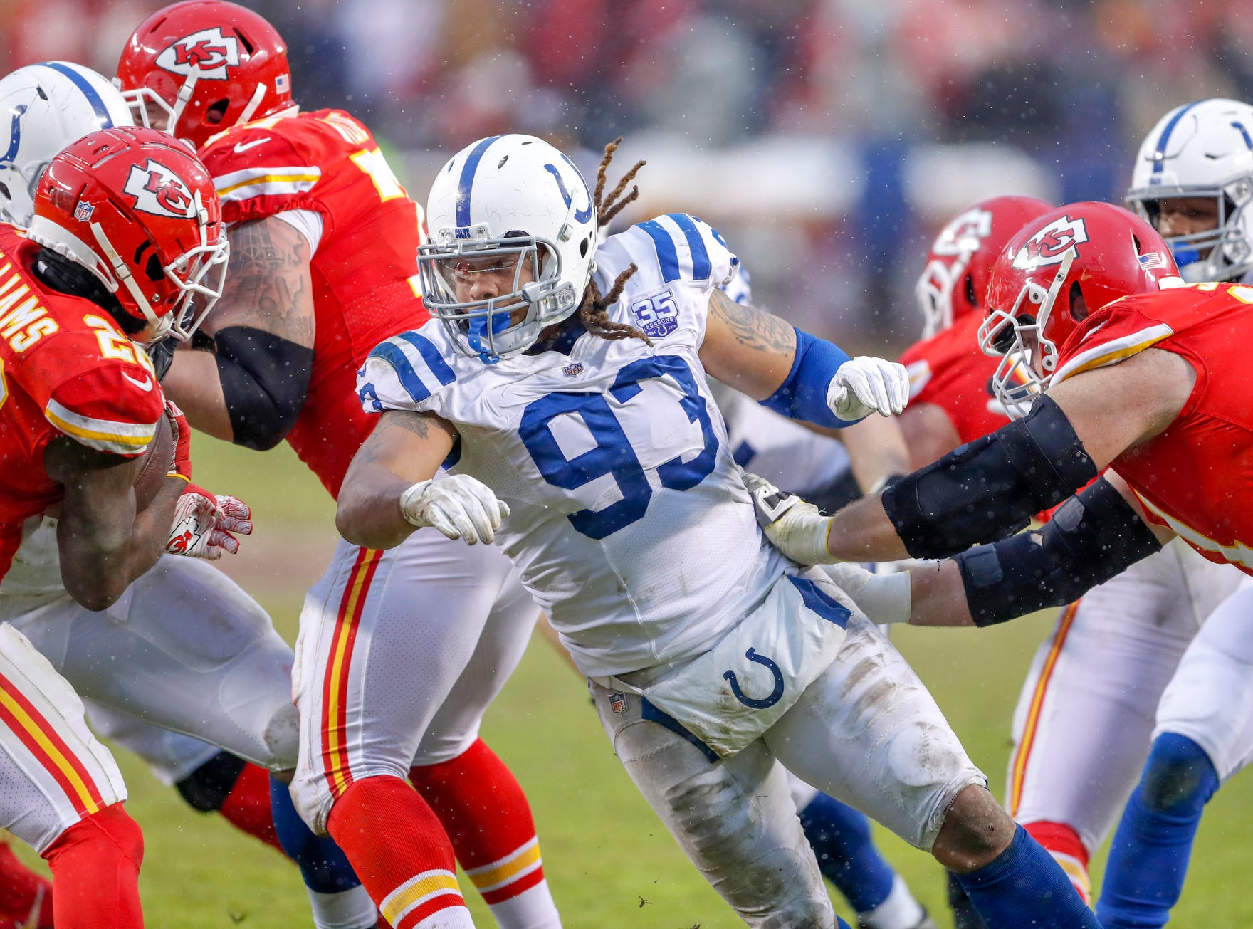 Indianapolis Colts defensive end Jabaal Sheard (93) rushes towards Kansas City Chiefs quarterback Patrick Mahomes (15) in the second quarter at Arrowhead Stadium in Kansas City, Mo., on Saturday, Jan. 12, 2019.