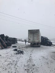 Northbound I-65 was partially closed Saturday afternoon around the 175-mile marker because of an overturned car and jack-knifed semi-truck.