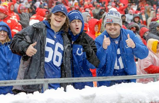 Indianapolis Colts fans cheer inside the Kansas City Chiefs' Arrowhead Stadium in Kansas City, Mo., on Saturday, Jan. 12, 2019.