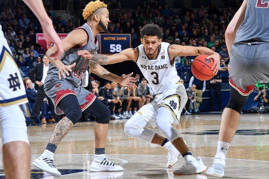 Jan 12, 2019; South Bend, IN, USA; Notre Dame Fighting Irish guard Prentiss Hubb (3) dribbles as Boston College Eagles guard Ky Bowman (0) defends in the second half at the Purcell Pavilion.